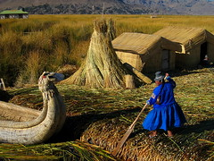 Lake Titicaca - Floating village (Py All) Tags: blue woman lake peru uros titicaca southamerica hat america island boat ship village dress robe south femme paddle floating lac bleu hut chapeau bateau rame sud puno hutte prou le amrique amriquedusud  villageflottant