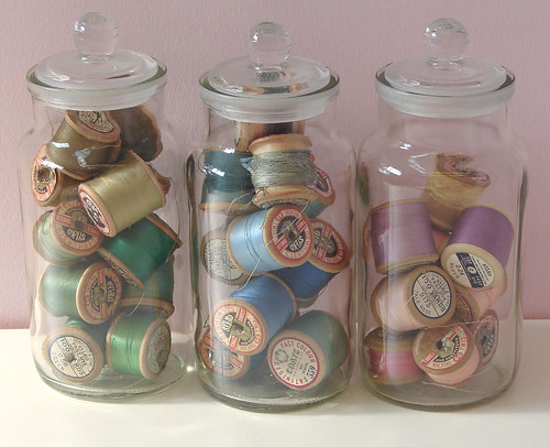 Vintage threads stored in glass jars