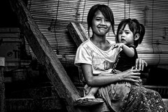 Ubud, Bali - Being Together (Mio Cade) Tags: travel girls portrait bw bali baby white black love girl kids sisters children indonesia photography kid hug toddler asia village child sister siblings human together southeast care ubud concern