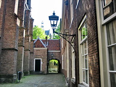 Delft, Waalse & Oude Kerk (Corien van Delft) Tags: blue orange holland netherlands dutch canal nederland delft paysbas olanda oranje niederlande 5photosaday koninkrijk