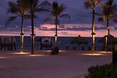 Sunset at Punta Mita (nanoox) Tags: ocean sunset orange beach clouds purple pacific palm fourseasons palapa puntamita