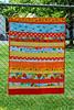 Sixth Orange Strip Quilt