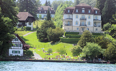 Hangin Out Lakeside (cwgoodroe) Tags: sun mountain lake snow alps green church statue ferry fairytale swimming switzerland boat europe locals suisse swiss sunny location farms movieset luce swissalps lucern medivil beerpasture
