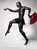 Red Fan 2 (skinr) Tags: metallic egyptian malemodel studiolighting humanform maledancer deepshadows redfan wwwjskinnerphotocom jasonjamesskinner lvcdt jetblackbodypaint