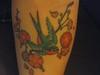 bird and cherry blossom tattoo 2 weeks on