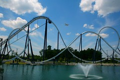 A plane soars of the Time Machine at Freestyle Music Park in Myrtle Beach, SC (char1iej) Tags: sc plane myrtlebeach pond amusementpark rollercoaster july4th independenceday timemachine hardrockpark charliej freesty