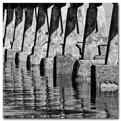 When Fonts Attack (s0ulsurfing) Tags: shadow sea blackandwhite bw sunlight white black reflection geometric water lines composition contrast reflections giant square concrete army island grey mono mirror march pier shadows geometry patterns jetty capital letters attack perspective monotone explore reflected illusion vectis isleofwight solent font barnacles ripples alphabet fonts frontpage isle 2009 invasion squared wight repitition typeface tripping bembridge reinforced a s0ulsurfing coastuk eastwight bembridgelifeboat bembridgebay