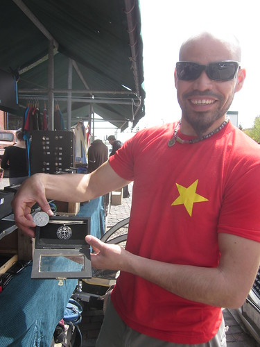 The arts market in the distillery district in Toronto and artist Cordo displays his hand crafted metal works.