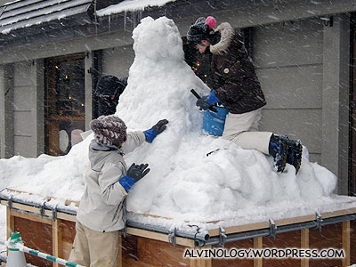 Braving the cold to make snowman