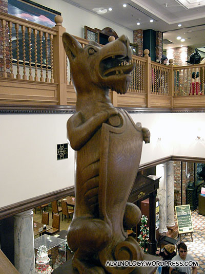 Wooden dog that guards the stairway