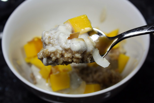 Steel-Cut Oatmeal with Mango, Toasted Coconut Flakes and Cardamom Yogurt
