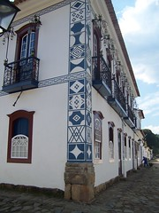 Corner of whitewashed building with blue detailing