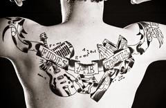 My new tattoo 2 (Onelog Photography) Tags: blackandwhite bw tattoo contrast photoshop studio back hands cross guitar faith flash praying banner ab grace edge math microphone fides alternative strobe mobius gratia