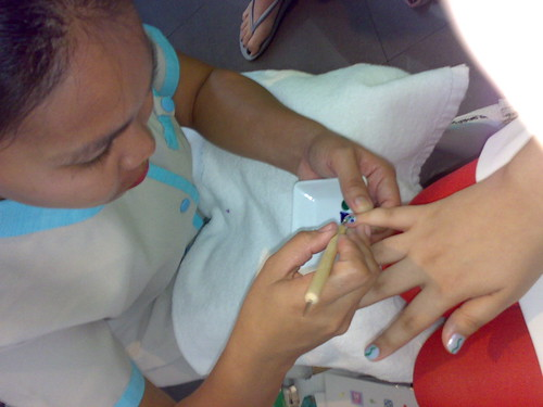 Nail Techician doing Nail Art - Nail Spa