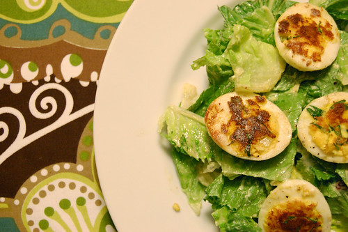 Pan-Seared Deviled Eggs on French Greens