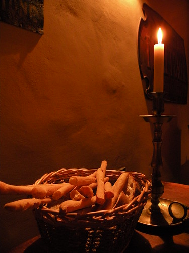 candle and breadsticks