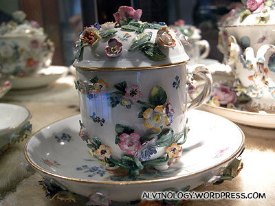 A cup heavily ornated with flowers