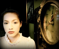 Startled by Time (Jade M. Sheldon) Tags: portrait white selfportrait reflection green clock me self wonder gold sweater eyes time lace girly startled lips jade sp bow ornate insomnia headband polkadot emilydickinson startle explored masterpiecesoflightdark toliveissostartlingitleaveslittletimeforanythingelse jademsheldon