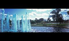 Panorama trashcam (kevin dooley) Tags: park blue trees arizona panorama film broken nature water fountain grass clouds analog lomo lomography az company velvia springs pan chandler chemical gila 100f trashcam