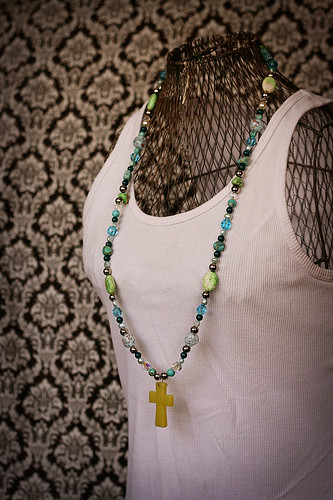 green cross with teal and silver
