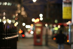 night fence ... :-) (_nejire_) Tags: uk red england man black blur color colour bus london canon fence eos kiss colours bokeh britain telephone 14 trafalgarsquare busstop colourful soe telephonebox planar londonbus carlzeiss 1030am 30faves fave20 10faves 20faves nejire 400d eos400d canoneos400d kissx fave10 fave30 nightfence mhashi planart1450ze 7531494g1025pm