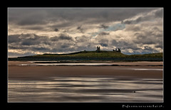 Dunstanburgh. (numanoid69) Tags: uk england castle beach reflections coast sand northumberland shore coastline dunstanburgh nikond300 prideofengland