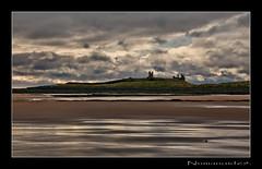 Dunstanburgh. (numanoid69) Tags: uk england castle beach reflections coast sand northumberland shore coastline dunstanburgh nikond300 prideofengland