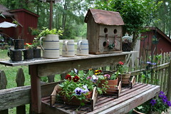 Flowers and Junk (milkmaid1979) Tags: flowers fence garden baskets pansies picket pottingtable