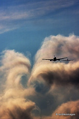 Wake turbulence (Greg Bajor) Tags: uk vortex london weather clouds plane airplane flying airport unitedkingdom heathrow aircraft aviation flight aeroplane landing forms behind boeing approach 777 747 aircrafts descending tailwind whirls chasingclouds commercialairliner waketurbulence wingtipvortices gregbajor