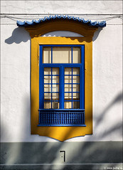 shadowed window (julioc.) Tags: blue houses windows urban white house portugal window beautiful yellow wall architecture ventana shadows geometry quality traditional nopeople olympus symmetry textures janela typical oldcity faade aveiro e510 bigmomma julioc challengeyouwinner photographybyjulioctheblog olympuse510 ilustrarportugal srieouro janelasportuguesas j2549 ilustrarportugal200904aveiro