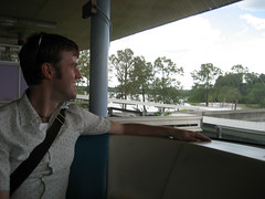 ian in the front of the tram on his way to disneyworld