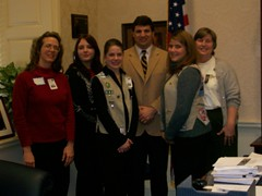 Senator Peters standing with the area Girl Scouts