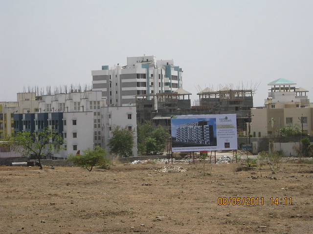 Site of Karia Developers' Konark Meadows - 1 BHK 2 BHK 3 BHK Flats - at RMC Garden Compound - behind Moze College - Wagholi - Nagar Road - Pune