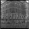 Guarded (pearmon) Tags: windows bw metal architecture fence iron texas bricks hasselblad scanned lockhart pfogold pfosilver