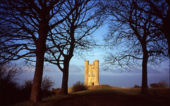 broadway tower (chirgy) Tags: trees winter england sky castle silhouette evening fuji branches broadway slide ps scan transparency worcestershire analogue velvia100 co