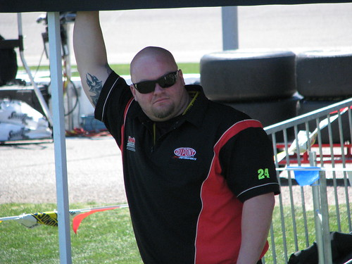 Mike Houston, tire carrier for the #24 Dupont pit crew of Jeff Gordon, seeks some shade on pit road.