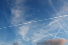 Busy skies (Elios.k) Tags: camera travel blue sky cloud moon white abstract color colour travelling amsterdam weather horizontal clouds canon airplane outdoors photography contrail aviation airplanes may nopeople clear trail contrails 2009 condensationtrails 450d rebelxsi