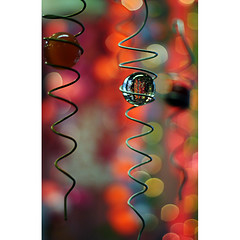 spirals and bokeh and spheres -- oh my! (helen sotiriadis) Tags: pink red orange green glass yellow mobile canon ball spiral published dof bokeh depthoffield sphere canonef50mmf14usm hbw canoneos40d toomanytribbles planningforfp
