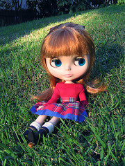 Maxine sits on the grassy bank