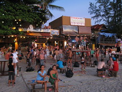 The beach as the sun rises after the Full Moon Party