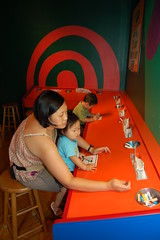Aki doing Color magic drawing with mama