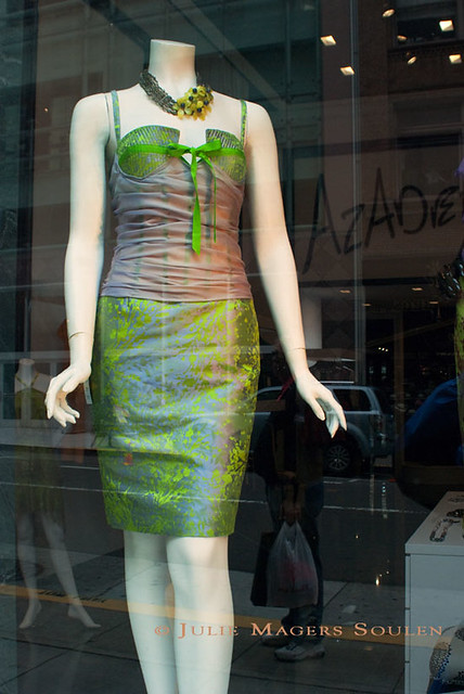a store front mannequin displays the latest haute couture in chartreuse for the a night at the theatre