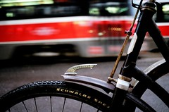 Rocket Blur (Georgie_grrl) Tags: red toronto ontario blur bicycle movement downtown nightshot ttc retro rainy pentaxk1000 queenstreetwest streetcar redrocket vaterland cans2s rikenon12828mm steampunklike