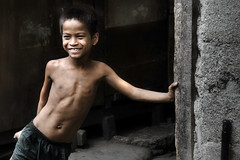 Mandaue, Barangay Subangdaku - A Shy Scavenger boy (Mio Cade) Tags: street camera travel boy shirtless portrait photography site kid asia village child philippines dump social shy hide cebu scavenger cebusugbo aplusphoto moodcreations