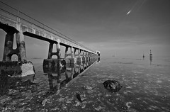 UFO (unidentified flare object) #3 - Reflections over Bembridge Lifeboat Station (again) (s0ulsurfing) Tags: ocean sea sky blackandwhite bw white seascape black seaweed reflection beach nature water lines composition contrast reflections landscape island grey mono mirror coast march pier skies quiet peace natural patterns jetty wide perspective shoreline wideangle monotone pebbles calm ufo aliens reflected coastal filter shore vectis isleofwight solent flare vista coastline grad landschaft isle 2009 diffused wight mellow subtle bembridge 10mm sigma1020 nd4 s0ulsurfing eastwight bembridgelifeboat bembridgebay