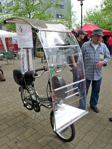 folding bike with rain protection canopy