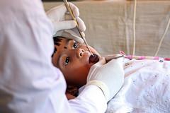 A dentist examines the teeth of a preschooler (World Bank Photo Collection) Tags: education asia child dental patient medical health srilanka dentist exam worldbank southasia examination
