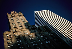 Portentous... (Trapac) Tags: city newyorkcity blue windows light shadow summer urban usa brown white newyork film sunshine architecture skyscraper buildings fuji centralpark manhattan 5thavenue slide lookingup nikkor50mmf18 e6 lightshadow nikonf80 officeblock 50iso fujivelvia wmh peakimaging flickrcollectionongetty oldoriginalvelvia50 processedscannedbypeakimagingsheffield gettymomentcreativecollection