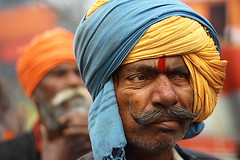 moustache & turban | Kolkata (arnabchat) Tags: portrait india man face eyes dof expression moustache turban favs bengal bangla pilgrim sankranti westbengal 50f18 pagri canon400d arnabchat arnabchatterjee kwsgangasagarcamp110109