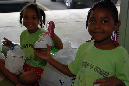 Girls from The Salvation Army Shelter for Women and Children show off their new shoes.